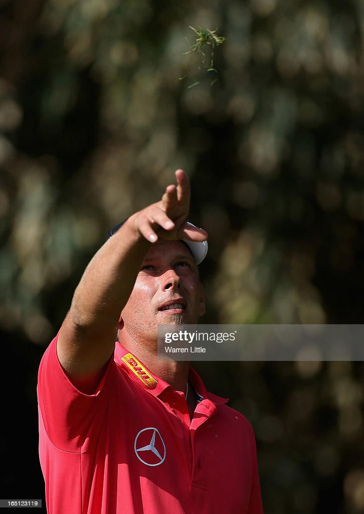 <a gi-track='captionPersonalityLinkClicked' href=/galleries/search?phrase=Marcel+Siem&family=editorial&specificpeople=167180 ng-click='$event.stopPropagation()'>Marcel Siem</a> of Germany tests the wind direction during the final round of the Trophee du Hassan II Golf at Golf du Palais Royal on March 31, 2013 in Agadir, Morocco.