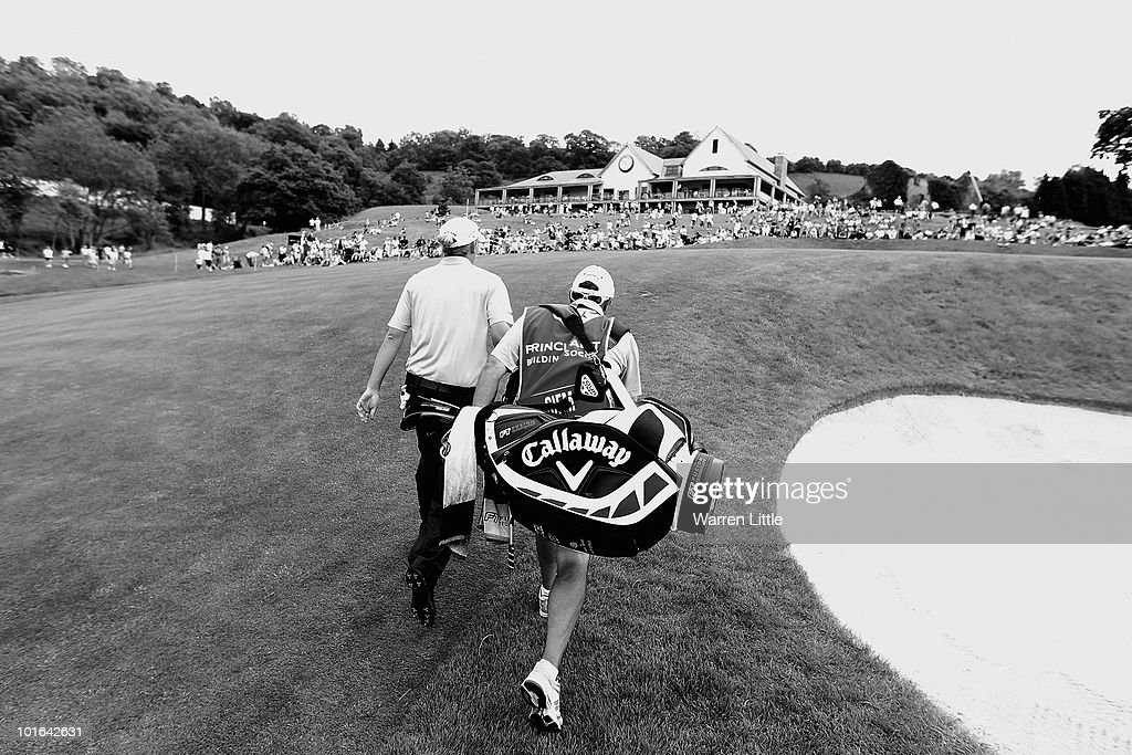 Marcel Siem of Germany walks up to the 18th green with his caddie Kyle Roadley during the third round of the Celtic Manor Wales Open on The Twenty Ten Course on June 5, 2010 in Newport, Wales.