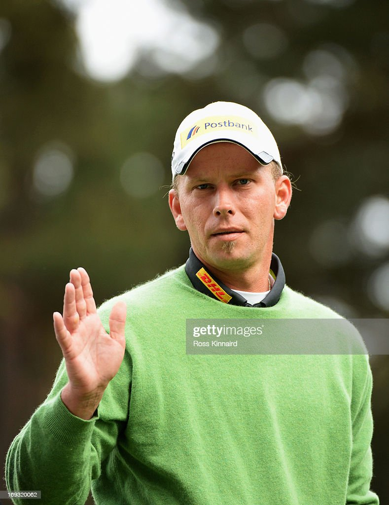 Marcel Siem of Germany waves during the first round of the BMW PGA Championship on the West Course at Wentworth on May 23, 2013 in Virginia Water, England.