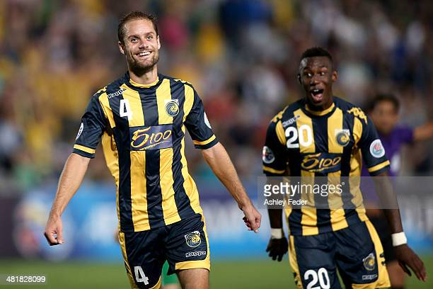 Marcel Siep and Bernie Ibini of the Mariners celebrate a goal during the Asian Champions League match between the Central Coast Mariners and Beijing...