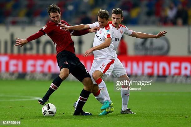 Marcel Sobottka of Duesseldorf and Julian Schauerte of Duesseldorf challenge Tim Matavz of Nuernberg during the Second Bundesliga match between...