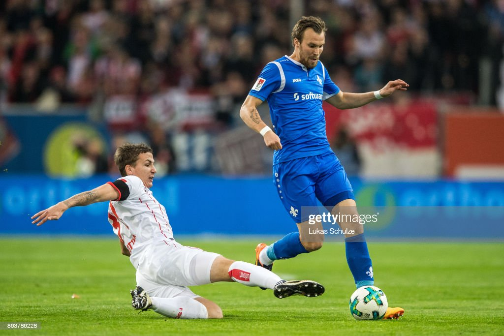 Marcel Sobottka (L) of Duesseldorf and Kevin Grosskreutz (R) of Darmstadt fight for the ball during the Second Bundesliga match between Fortuna Duesseldorf and SV Darmstadt 98 at Esprit-Arena on October 20, 2017 in Duesseldorf, Germany.