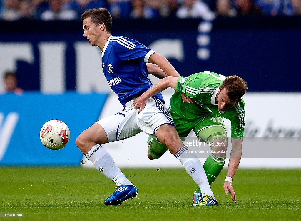 Marcel Sobottka of Schalke and <a gi-track='captionPersonalityLinkClicked' href=/galleries/search?phrase=Maximilian+Arnold&family=editorial&specificpeople=7166144 ng-click='$event.stopPropagation()'>Maximilian Arnold</a> of Wolfsburg battle for the ball during the A Juniors Championships semifinal second leg match between Schalke 04 and VfL Wolfsburg at Veltins-Arena on June 18, 2013 in Gelsenkirchen, Germany.