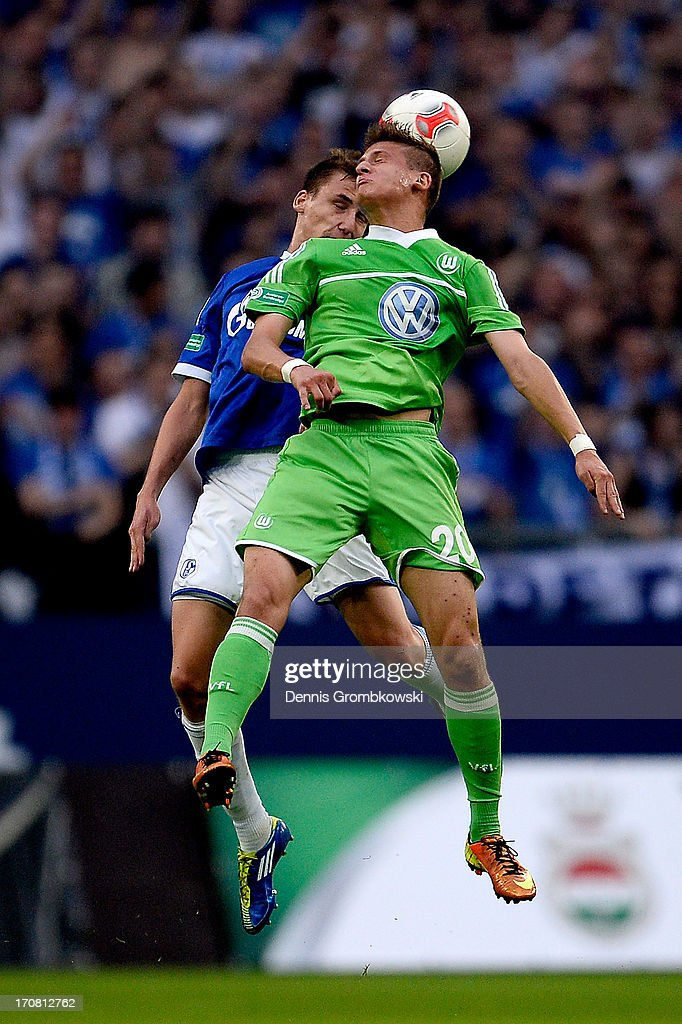Marcel Sobottka of Schalke and Tugay Uzan of Wolfsburg go for a header during the A Juniors Championships semifinal second leg match between Schalke 04 and VfL Wolfsburg at Veltins-Arena on June 18, 2013 in Gelsenkirchen, Germany.