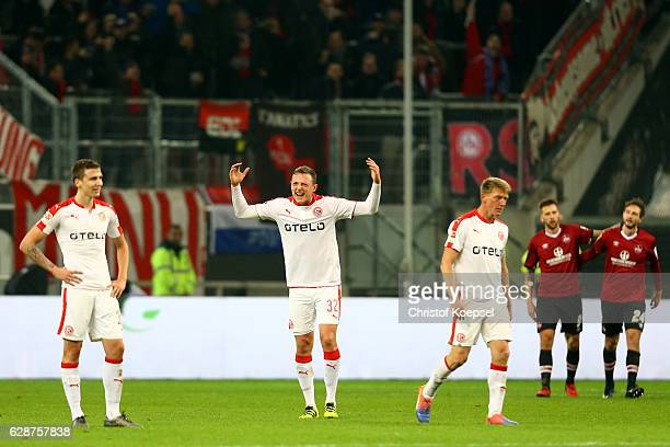 Marcel Sobottka Robin Bormuth and Axel Bellinghausen of Duesseldorf look dejected after the second goal of Nuernberg by Tim Matavz of Nuernberg...