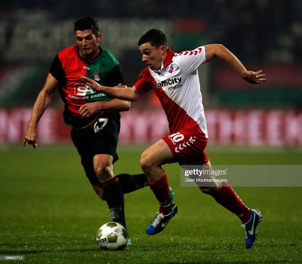 Marcel Stutter of NEC is beaten by Tommy Oar (#10) of Utrecht during the Eredivisie match between NEC Nijmegen and FC Utrecht at the McDOS Goffertstadion on November 24, 2012 in Nijmegen, Netherlands.