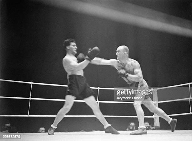 Marcel Thil champion du monde des poids moyens bat aux points Gustave Roth alors champion d'Europe lors d'un match de boxe pour le championnat du...