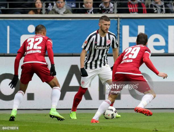 Marcel Tisserand of Ingolstadt and Ante Rebic of Frankfurt and Markus Suttner of Ingolstadt battle for the ball during the Bundesliga match between...