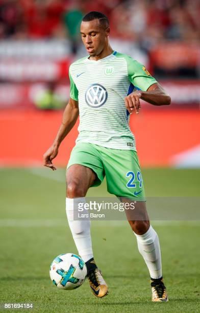 Marcel Tisserand of Wolfsburg runs with the ball during the Bundesliga match between Bayer 04 Leverkusen and VfL Wolfsburg at BayArena on October 15...