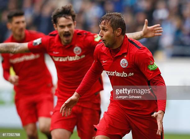Marcel Ziemer of Rostock celebrates after scoring during the third league match between MSV Duisburg and Hansa Rostock at SchauinslandReisenArena on...
