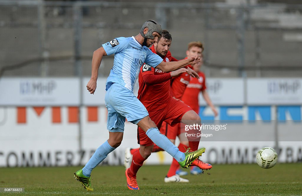 Marcel Ziemer (r) of Rostock challenges Klaus Gjasula of Stuttgart during the 3. Liga match between SV Stuttgarter Kickers and FC Hansa Rostock at GAZI-Stadion on February 6, 2016 in Stuttgart, Germany.
