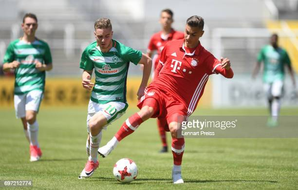 Marcel Zylla of FC Bayern Muenchen challenges David Lennart Philip of SV Werder Bremen during the B Juniors German Championship Final between FC...