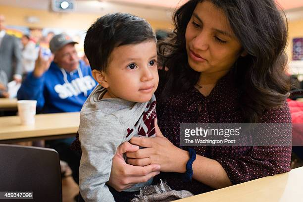 HYATTSVILLE MD NOVEMBER Marcela Campos of Silver Spring holds her 2yearold US born son Abraham MezaCampos as she waits for the immigration...