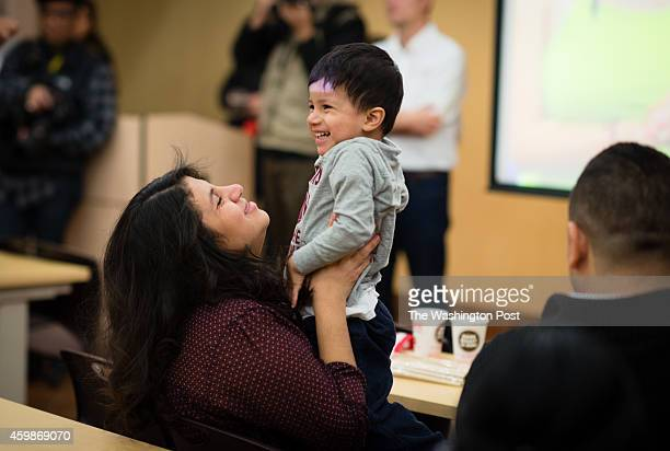 Marcela Campos of Silver Spring holds her 2yearold US born son Abraham MezaCampos as she waits for the immigration announcement Obama's announcement...