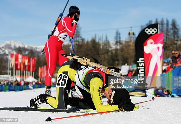 Marcela Pavkovcekova of Slovakia collapses at the finish line after competing in the Womens Biathlon 15km Individual Final on Day 3 of the 2006 Turin...