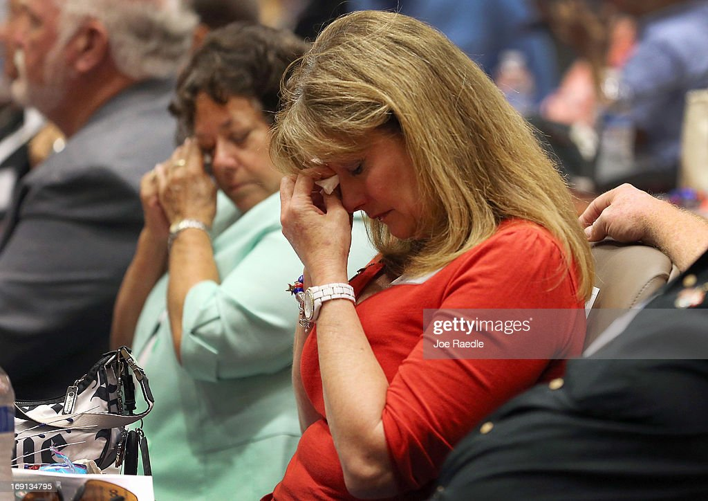 Marcela Rice (L) and Faye Wade are overcome with emotion as they remember their children during a ceremony to remember and honor those who have died in service to the nation and the families they have left behind at U.S. Southern Command headquarters on May 20, 2013 in Doral, Florida. U.S. Marine Gen. John Kelly presided over the ceremony where the families of 57 fallen service members from South Florida were invited to attend.