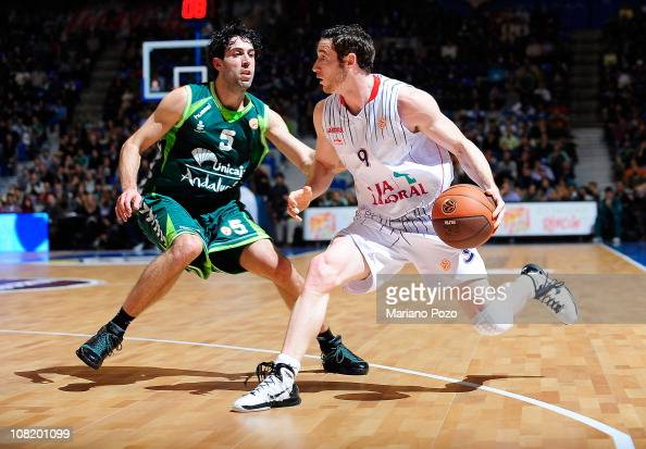 Marcelinho Huertas #9 of Caja Laboral competes with Berni Rodriguez #5 of Unicaja during the 20102011 Turkish Airlines Euroleague Top 16 Date 1 game...