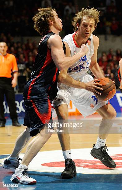 Marcelinho Huertas #9 of Caja Laboral competes with Zoran Planinic #34 of CSKA Moscow during the Euroleague Basketball 20092010 Play Off Game 3...
