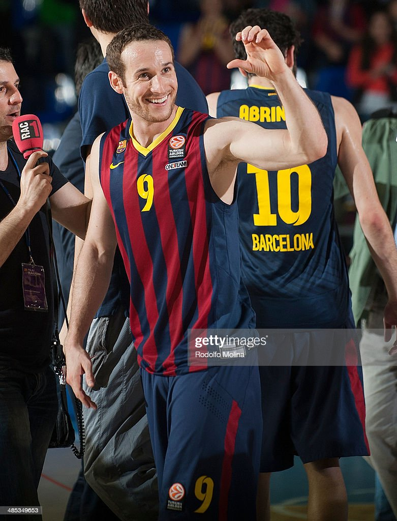 Marcelinho Huertas, #9 of FC Barcelona celebrates after wining the Turkish Airlines Euroleague Basketball Play Off Game 2 between FC Barcelona Regal v Galatasaray Liv Hospital Istanbul at Palau Blaugrana on April 17, 2014 in Barcelona, Spain.