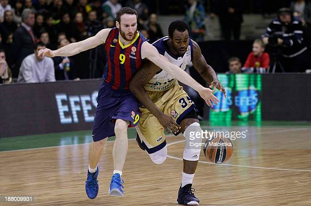 Marcelinho Huertas #9 of FC Barcelona competes with Dajuan Summers #35 of Budivelnik Kiev during the 20132014 Turkish Airlines Euroleague Regular...