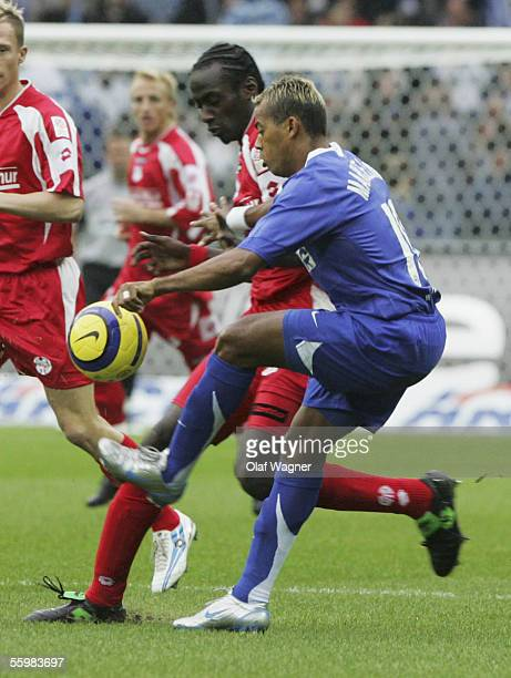 Marcelinho of Hertha BSC Berlin and Otto Addo of Mainz battle for the ball during the Bundesliga match between Hertha BSC Berlin and FSV Mainz 05 at...