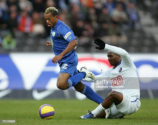 Marcelinho of Wolfsburg challenges for the ball with Gilberto of Berlin during the Bundesliga match between Hertha BSC Berlin and VFL Wolfsburg at...