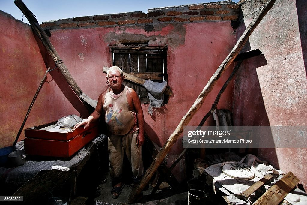 Marcelino Velazquez Valdez stands amid the ruins of his home after Hurricane Ike Ike tore through a week earlier September 15 Gibara Cuba Cuba...