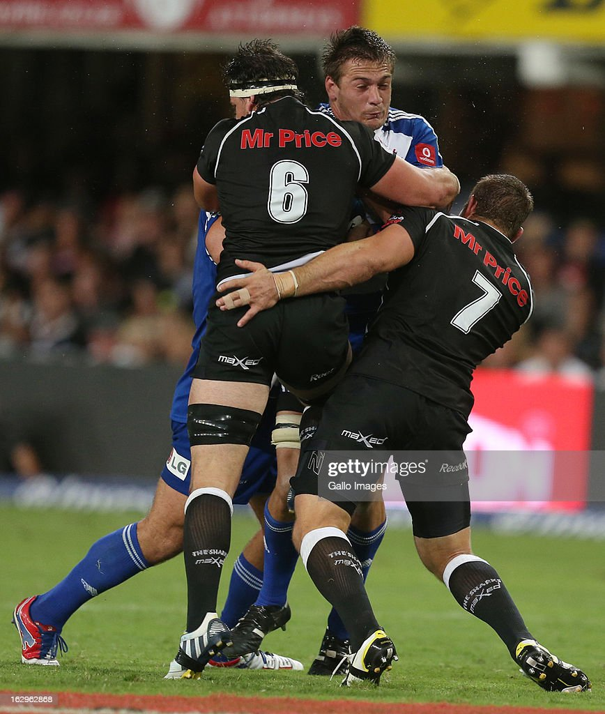 AFRICA - MARCH 02, Marcell Coetzee and Jean Deysel tackle Rynhardt Elstadt during the Super Rugby match between The Sharks and DHL Stormers at Kings Park on March 02, 2013 in Durban, South Africa.