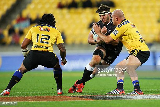 Marcell Coetzee of the Sharks is tackled by Ben Franks of the Hurricanes during the round 13 Super Rugby match between the Hurricanes and the Sharks...