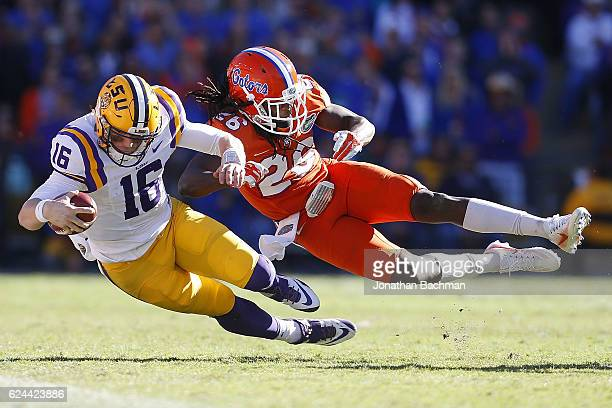 Marcell Harris of the Florida Gators tackles Danny Etling of the LSU Tigers during the second half of a game at Tiger Stadium on November 19 2016 in...