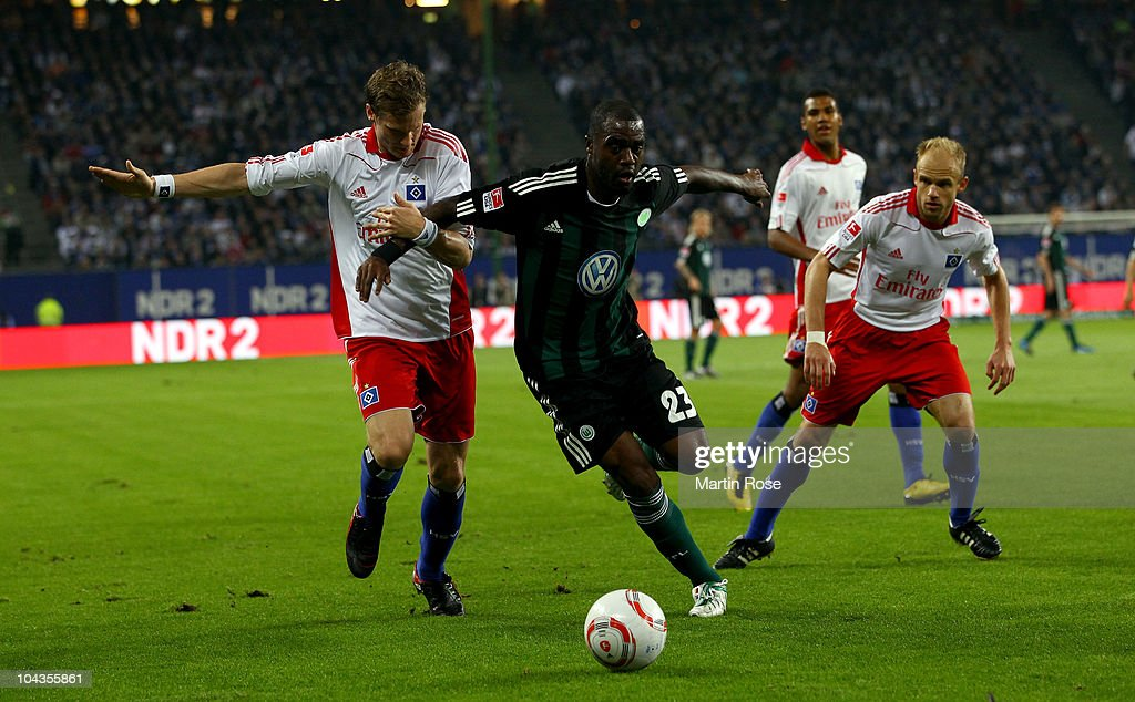 Marcell Jansen (L) of Hamburg and Grafite (R) of Wolfsburg battle for the ball during the Bundesliga match between Hamburger SV and VFL Wolfsburg at Imtech Arena on September 22, 2010 in Hamburg, Germany.