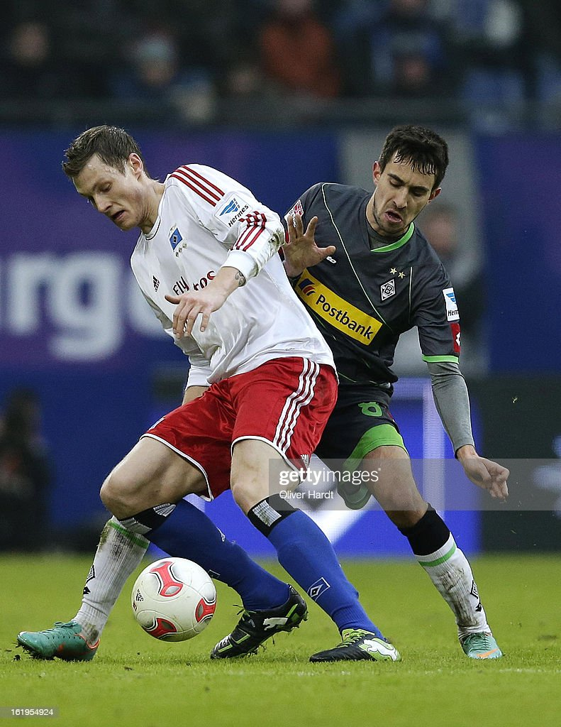 Marcell Jansen (R) of Hamburg and Lukas Rupp (R) of Gladbach battle for the ball during the Bundesliga match between Hamburger SV and Borussia Moenchengladbach at Imtech Arena on February 16, 2013 in Hamburg, Germany.