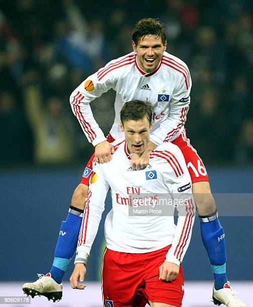 Marcell Jansen of Hamburg celebrates after scoring his team's first goal with team mate Marcus Berg during the UEFA Europa League Group C match...