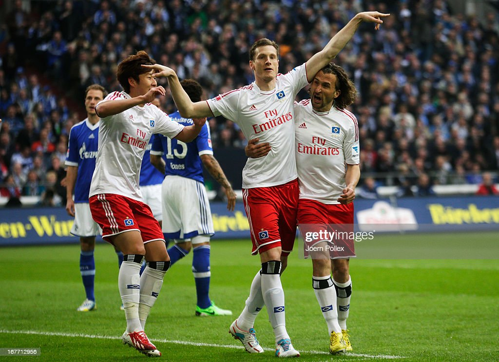 <a gi-track='captionPersonalityLinkClicked' href=/galleries/search?phrase=Marcell+Jansen&family=editorial&specificpeople=236023 ng-click='$event.stopPropagation()'>Marcell Jansen</a> (C) of Hamburg celebrates with his team mates after scoring his team's first goal during the Bundesliga match between FC Schalke 04 and Hamburger SV at Veltins-Arena on April 28, 2013 in Gelsenkirchen, Germany.