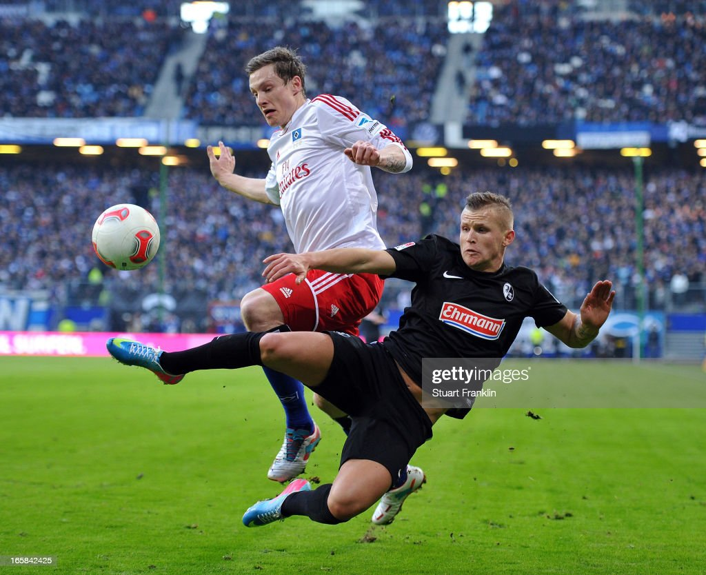 <a gi-track='captionPersonalityLinkClicked' href=/galleries/search?phrase=Marcell+Jansen&family=editorial&specificpeople=236023 ng-click='$event.stopPropagation()'>Marcell Jansen</a> of Hamburg challenges for the ball with Jonathan Schmid of Freiburg during the Bundesliga match between Hamburger SV and SC Freiburg at Imtech Arena on April 6, 2013 in Hamburg, Germany.