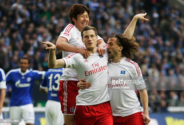 Marcell Jansen of Hamburgcelebrates with his team mates after scoring his team's first goal during the Bundesliga match between FC Schalke 04 and...