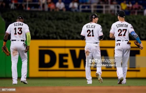 Marcell Ozuna Christian Yelich and Giancarlo Stanton of the Miami Marlins during the game against the Atlanta Braves at Marlins Park on October 1...