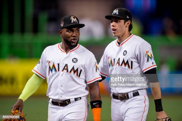 Marcell Ozuna interacts with Christian Yelich during the game against the Atlanta Braves at Marlins Park on September 28 2017 in Miami Florida
