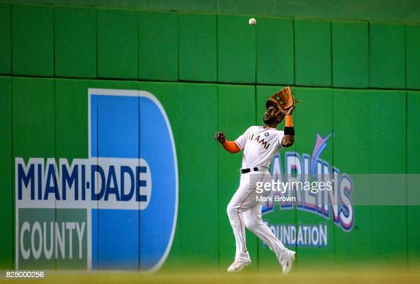 Marcell Ozuna of the Miami Marlins catches the ball for an out in the second inning during the game between the Miami Marlins and the Washington...