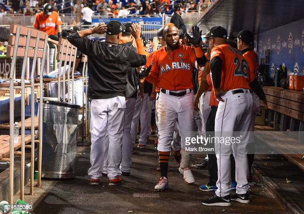 Marcell Ozuna of the Miami Marlins celebrates a homerun in ninth inning during the game between the Miami Marlins and the Cincinnati Reds at Marlins...