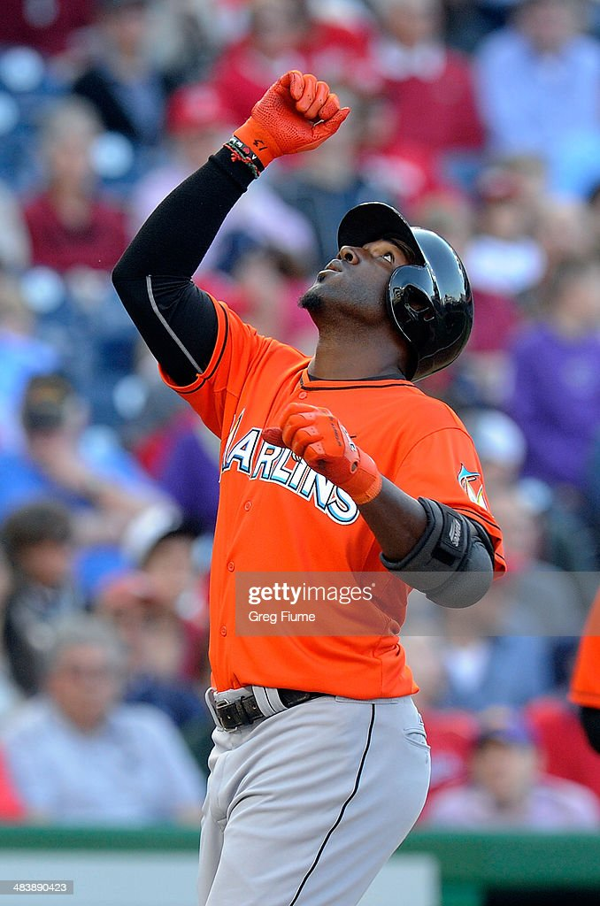 <a gi-track='captionPersonalityLinkClicked' href=/galleries/search?phrase=Marcell+Ozuna&family=editorial&specificpeople=10358366 ng-click='$event.stopPropagation()'>Marcell Ozuna</a> #13 of the Miami Marlins celebrates after hitting a home run in the seventh inning against the Washington Nationals at Nationals Park on April 10, 2014 in Washington, DC.
