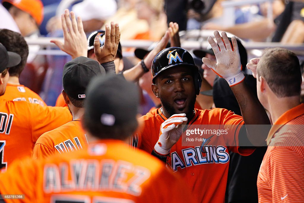 <a gi-track='captionPersonalityLinkClicked' href=/galleries/search?phrase=Marcell+Ozuna&family=editorial&specificpeople=10358366 ng-click='$event.stopPropagation()'>Marcell Ozuna</a> #13 of the Miami Marlins celebrates after scoring during the seventh inning of the game against the Arizona Diamondbacks at Marlins Park on August 17, 2014 in Miami, Florida.