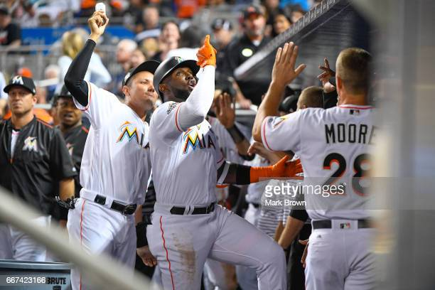 Marcell Ozuna of the Miami Marlins celebrates his second home run in the fifth inning in the home opener against the Atlanta Braves at Marlins Park...