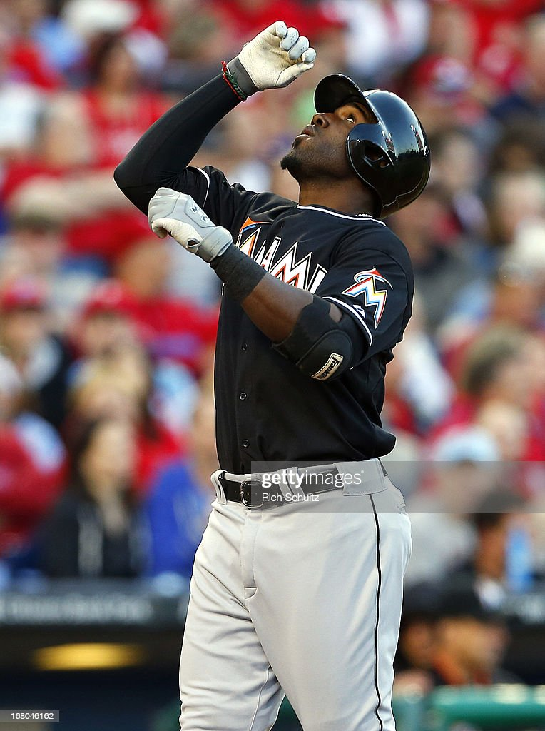 Marcell Ozuna #48 of the Miami Marlins gestures skyward after hitting a home run in the second inning against the Philadelphia Phillies in a MLB baseball game on May 4, 2013 at Citizens Bank Park in Philadelphia, Pennsylvania.