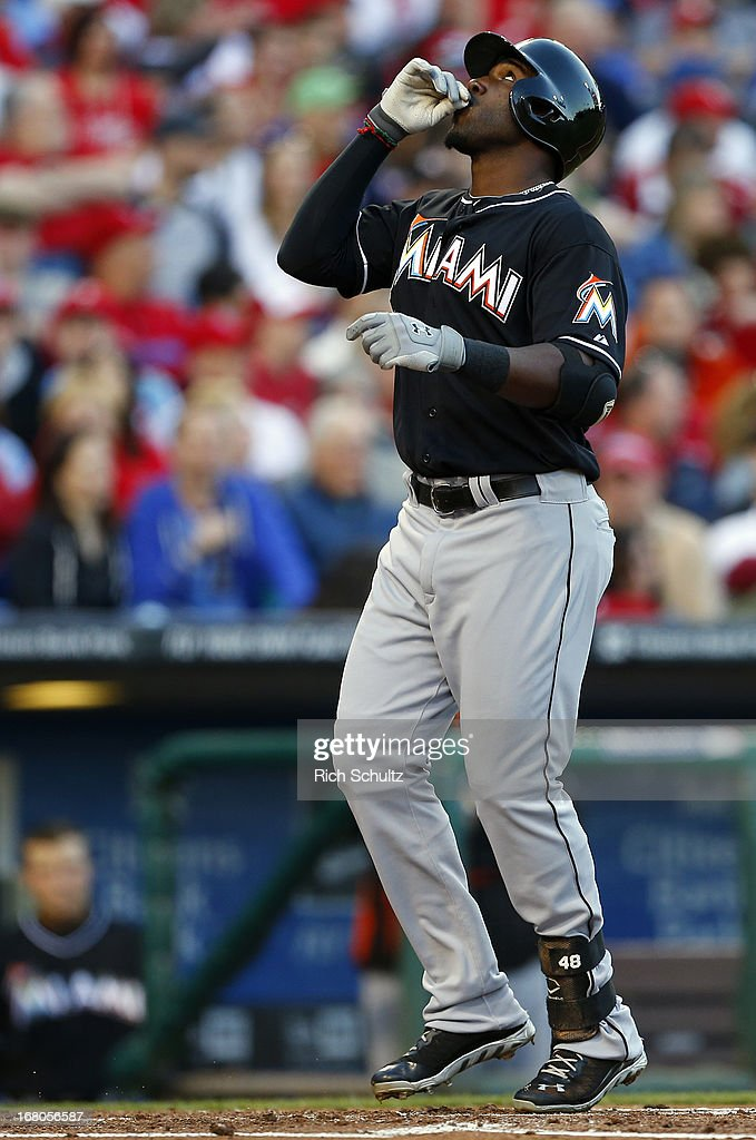 Marcell Ozuna #48 of the Miami Marlins gestures skyward after hitting his first career home run in the second inning against the Philadelphia Phillies in a MLB baseball game on May 4, 2013 at Citizens Bank Park in Philadelphia, Pennsylvania. The Marlins defeated the Phillies 2-0.