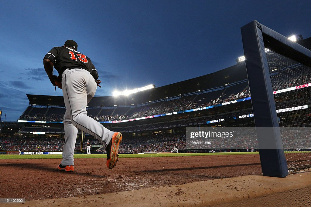 <a gi-track='captionPersonalityLinkClicked' href=/galleries/search?phrase=Marcell+Ozuna&family=editorial&specificpeople=10358366 ng-click='$event.stopPropagation()'>Marcell Ozuna</a> #13 of the Miami Marlins heads out onto the field against the Atlanta Braves at Turner Field on August 30, 2014 in Atlanta, Georgia.