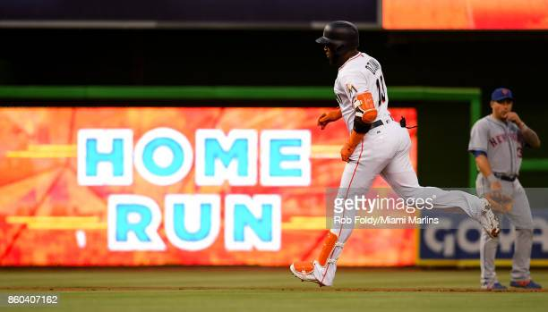 Marcell Ozuna of the Miami Marlins hits a home run during the game against the New York Mets at Marlins Park on April 13 2017 in Miami Florida