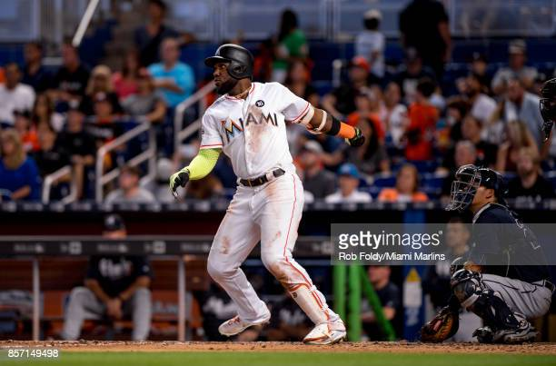 Marcell Ozuna of the Miami Marlins hits a home run during the seventh inning of the game against the Atlanta Braves at Marlins Park on October 1 2017...