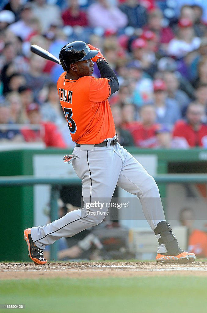 <a gi-track='captionPersonalityLinkClicked' href=/galleries/search?phrase=Marcell+Ozuna&family=editorial&specificpeople=10358366 ng-click='$event.stopPropagation()'>Marcell Ozuna</a> #13 of the Miami Marlins hits a home run in the seventh inning against the Washington Nationals at Nationals Park on April 10, 2014 in Washington, DC.