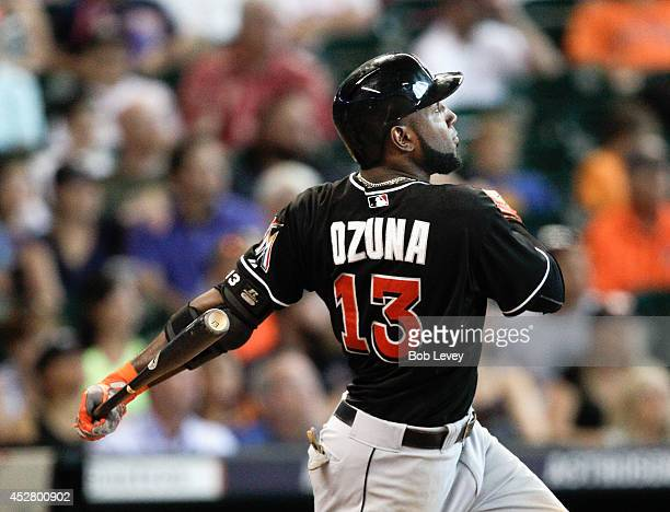Marcell Ozuna of the Miami Marlins hits a home run in the sixth inning against the Houston Astros at Minute Maid Park on July 27 2014 in Houston Texas